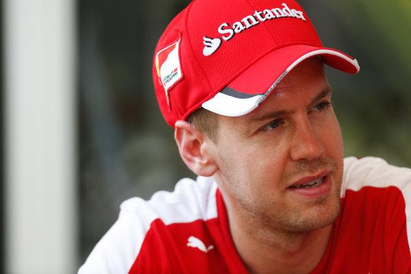 Sepang International Circuit, Sepang, Kuala Lumpur, Malaysia. Thursday 26 March 2015. Sebastian Vettel, Ferrari. World Copyright: Alastair Staley/LAT Photographic. ref: Digital Image _79P0474
