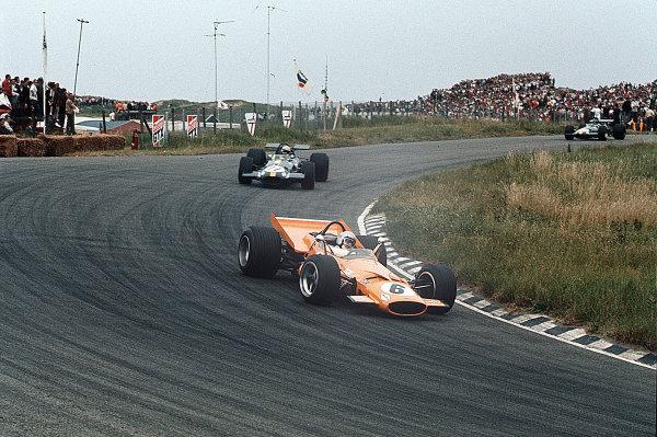 Zandvoort, Holland.19-21 June 1969.Bruce McLaren (McLaren M7C Ford) leads Jack Brabham and Jacky Ickx (both Brabham BT26A Ford's).Ref-35mm 69 HOL 26.World Copyright - LAT Photographic