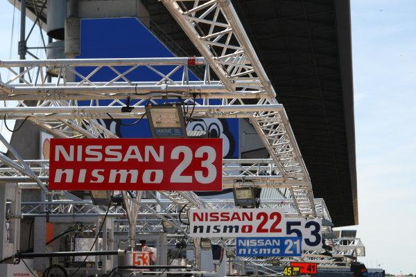 2015 Le Mans 24 Hours.  Circuit de la Sarthe, Le Mans, France.  Sunday 7 June 2015.  Garage marker signs for the Nissan Motorsports (Nissan GT-R LM Nismo - LMP1), Olivier Pla, Jann Mardenborough, Max Chilton, Nissan Motorsports (Nissan GT-R LM Nismo - LMP1), Harry Tincknell, Michael Krumm, Alex Buncombe and Nissan Motorsports (Nissan GT-R LM Nismo - LMP1), Tsugio Matsuda, Mark Shulzhitskiy, Lucas Ordonez cars. World Copyright: Ebrey/LAT Photographic.  ref: Digital Image DDLP3498