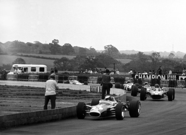 1967 British Grand Prix.Silverstone, Great Britain. 15 July 1967.Jim Clark, Lotus 49-Ford, 1st position, leads Graham Hill, Lotus 49-Ford, retired, Chris Amon, Ferrari 312, 3rd position, Jack Brabham, Brabham BT24-Repco, 4th position, and Dan Gurney, Eagle AAR104-Weslake, retired, action.World Copyright: LAT PhotographicRef: 1633 #0