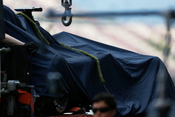 Circuit de Catalunya, Barcelona, Spain.  Wednesday 18 May 2016.  The Toro Rosso STR11 Ferrari of Daniil Kvyat is returned to the pits, under a cover, on a recovery truck following an off-track incident. World Copyright: Sam Bloxham/LAT Photographic ref: Digital Image _R6T1927