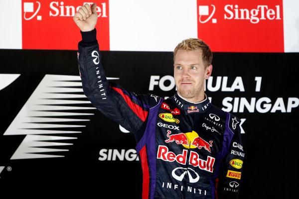 Marina Bay Circuit, Singapore. Sunday 22nd September 2013.  Sebastian Vettel, Red Bull Racing, celebrates on the podium.  World Copyright: Glenn Dunbar/LAT Photographic. ref: Digital Image _89P1278