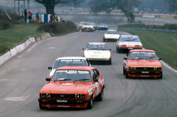 1980 British Saloon Car Championship. Mallory Park, England. 23rd March 1980. Rd 1. Gordon Spice (Ford Capri III 3.0S), 2nd position, leads Vince Woodman (Ford Capri III 3.0S), 3rd position, Andy Rouse (Ford Capri III 3.0S), 1st position and Win Percy (Mazda RX-7), 4th position, action.  World Copyright: LAT Photographic. Ref:  Colour Transparency.