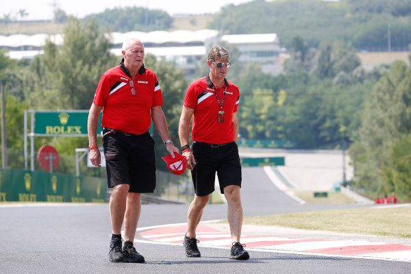 Hungaroring, Budapest, Hungary. Thursday 23 July 2015. John Booth, Team Principal, Manor F1, and Greame Lowdon, President and Sporting Director, Manor F1, walk the track. World Copyright: Alastair Staley/LAT Photographic ref: Digital Image _R6T7857