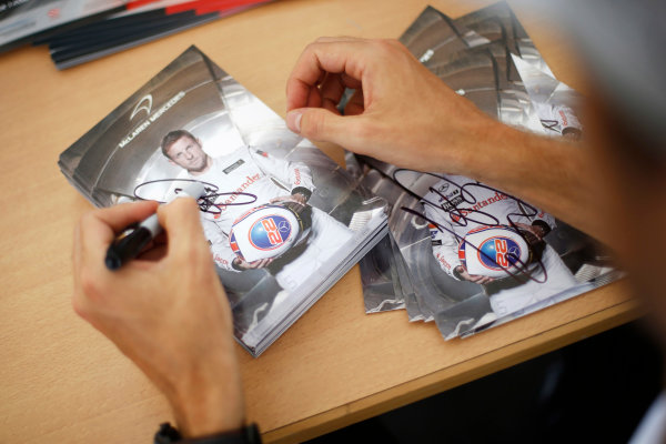 Hockenheimring, Hockenheim, Germany. Saturday 19 July 2014. Jenson Button, McLaren, signs autographs for fans. World Copyright: Charles Coates/LAT Photographic. ref: Digital Image _J5R4414