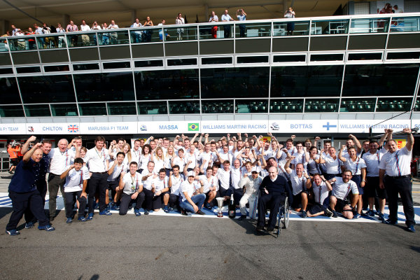 Autodromo Nazionale di Monza, Monza, Italy. Sunday 7 September 2014. Felipe Massa, Williams F1, 3rd Position, Sir Frank Williams, Team Principal, Williams F1, and the Williams team celebrate. World Copyright: Glenn Dunbar/LAT Photographic. ref: Digital Image _W2Q0652
