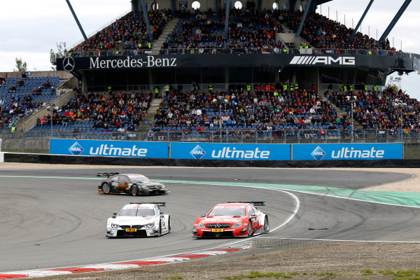 2014 DTM Championship Round 7 - Nurburgring, Germany 15th - 17th August 2014 Martin Tomczyk (GER) BMW Team Schnitzer BMW M4 DTM and Vitaly Petrov (RUS) Mercedes AMG DTM-Team M?cke DTM Mercedes AMG C-Coup? World Copyright: XPB Images / LAT Photographic  ref: Digital Image 3256933_HiRes