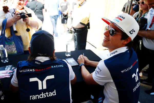 Circuit Gilles Villeneuve, Montreal, Canada. Thursday 08 June 2017. Lance Stroll, Williams Martini Racing, and Felipe Massa, Williams Martini Racing, sign autographs for fans. World Copyright: Andy Hone/LAT Images ref: Digital Image _ONZ9875