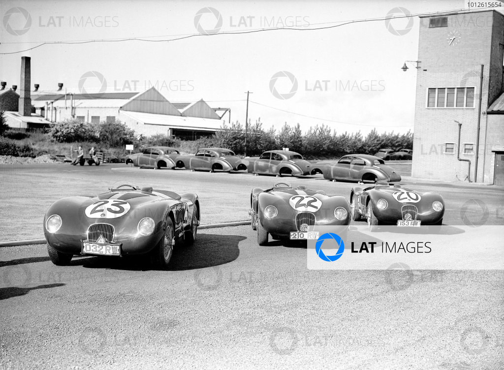 Le Mans, France. 23-24 June 1951.The victorious Jaguar team outside the factory. The winning C-type of Peter Walker/Peter Whitehead (number 20) with sister cars of Stirling Moss/Jack Fairman (number 22) and Leslie Johnson/Clemente Biondetti (number 23).Ref-Motor 779/53.World Copyright - LAT Photographic