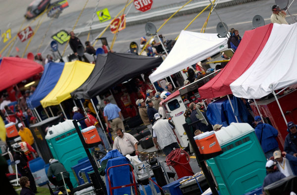 04-06 June, 2004, Dover International Speedway, USA,The tents go up as the rain comes down during the busch event,Copyright-Robt LeSieur 2004 USALAT Photographic