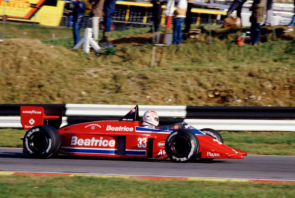 1985 European Grand Prix.Brands Hatch, England.4-6 October 1985.Alan Jones (Team Haas/Lola THL1 Hart).  Ref: 85EUR39. World Copyright - LAT Photographic