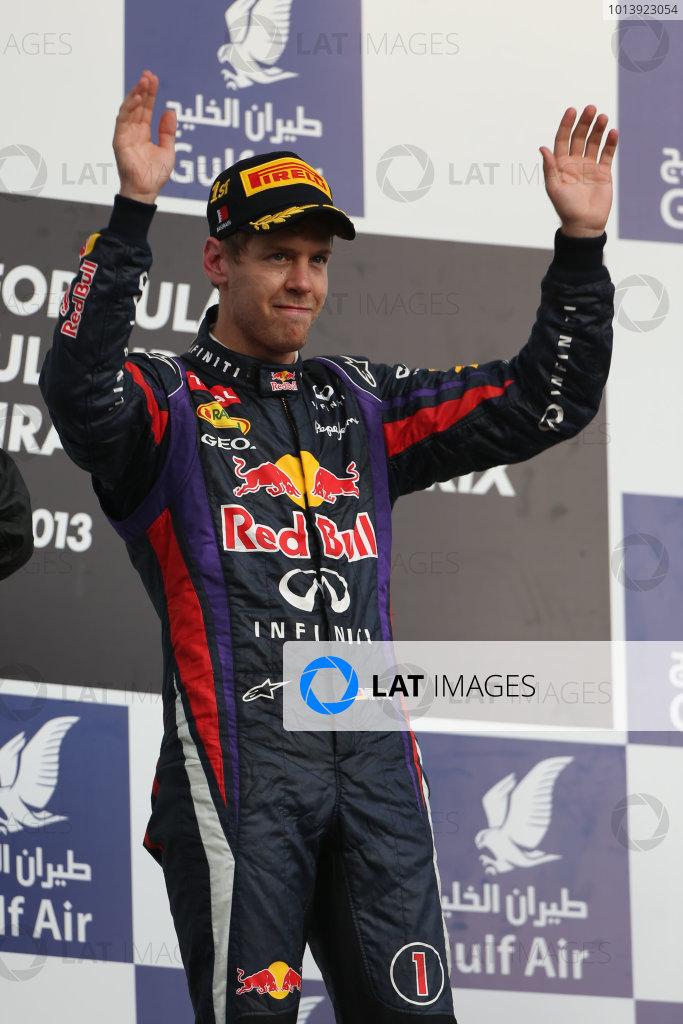 Bahrain International Circuit, Sakhir, Bahrain Sunday 21st April 2013 Sebastian Vettel, Red Bull Racing, 1st position, celebrates on the podium. World Copyright: Andy Hone/LAT Photographic ref: Digital Image HONZ2991
