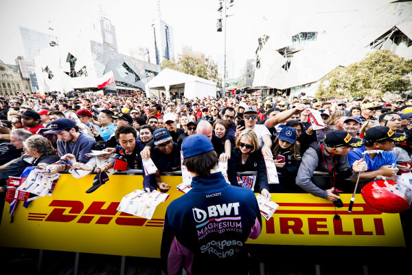 Lance Stroll, Racing Point signs autographs for fans at the Federation Square event.