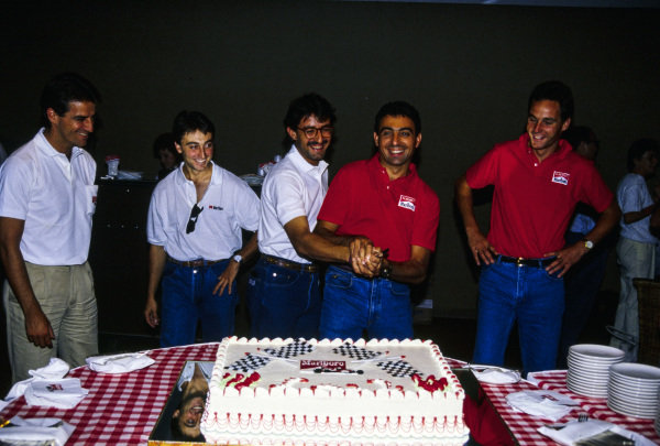 Alessandro Nannini, Adrian Campos, Ivan Capelli, Michele Alboreto and Gerhard Berger stand behind a cake