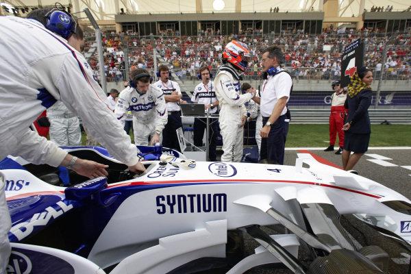 BMW Motorsport director Dr. Mario Theissen wishes Robert Kubica luck for the race.