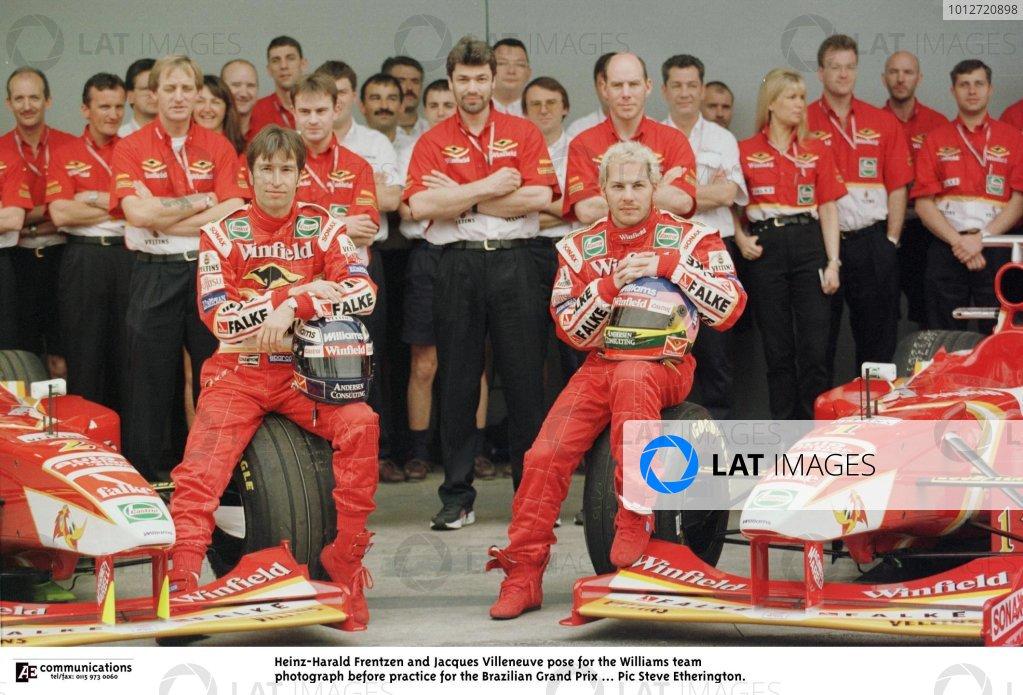 1998 Brazilian Grand Prix.Interlagos, Sao Paulo, Brazil.27-29 March 1998.Heinz-Harald Frentzen, Jacques Villeneuve and the Williams team pose for the press.World Copyright - Steve Etherington/LAT Photographic