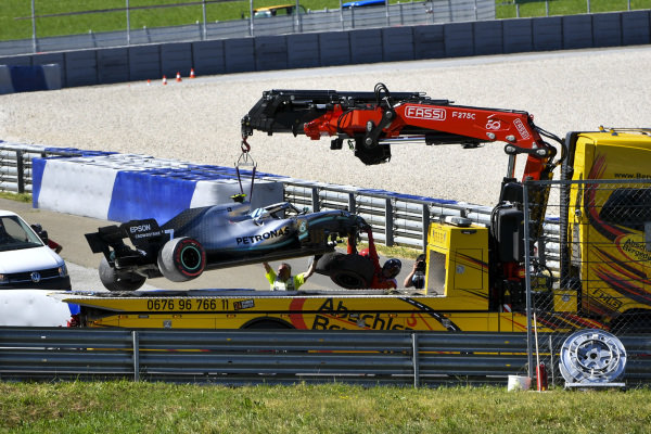 Marshals remove the damaged car of Valtteri Bottas, Mercedes AMG W10, after his crash at turn 6