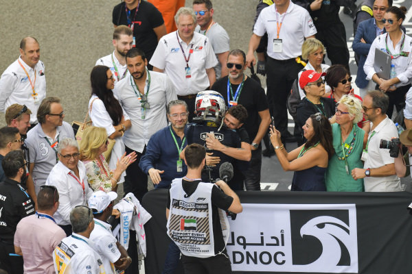 Nicholas Latifi (CAN, DAMS), celebrates second place in parc ferme. The parents of Lando Norris look on