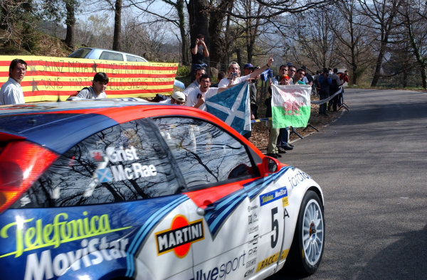 2002 World Rally ChampionshipRally Catalunya, 21st-24th March 2002.Colin McRae passes some British fans on his way to the second stage of Day 2.Photo: Ralph Hardwick/LAT