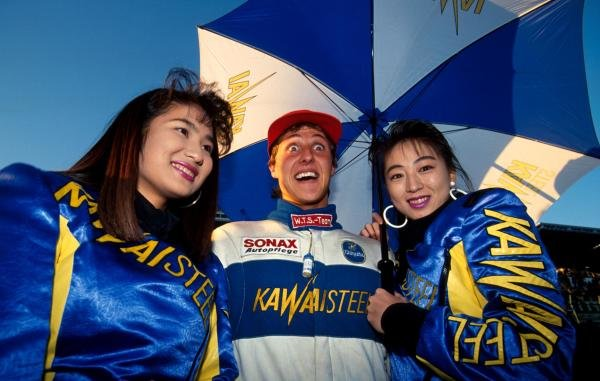 The thought of having two girls at once is all a bit too much for race winner Michael Schumacher (GER).   International Formula Three, Euro-Macau-Japan Cup, Fuji Speedway, Japan, 2 December 1990.