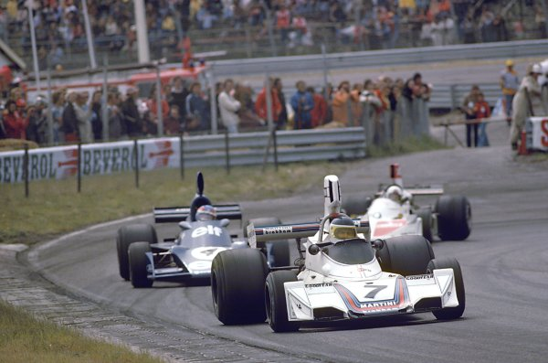 1975 Dutch Grand Prix.Zandvoort, Holland. 22 June 1975.Carlos Reutemann, Brabham BT44B-Ford, 4th position, leads Patrick Depailler, Tyrrell 007-Ford, 9th position, and Lella Lombardi, March 751-Ford, 14th position, action.World Copyright: LAT PhotographicRef: 35mm transparency 75HOL