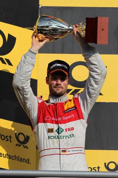 Martin Tomczyk (GER), Audi Sport Team Phoenix  (2nd) celebrates with his trophy on the podium.DTM, Rd10, Hockenheim, Germany, 22-23 October 2011 World Copyright: LAT Photographicref: Digital Image dne1123oc80
