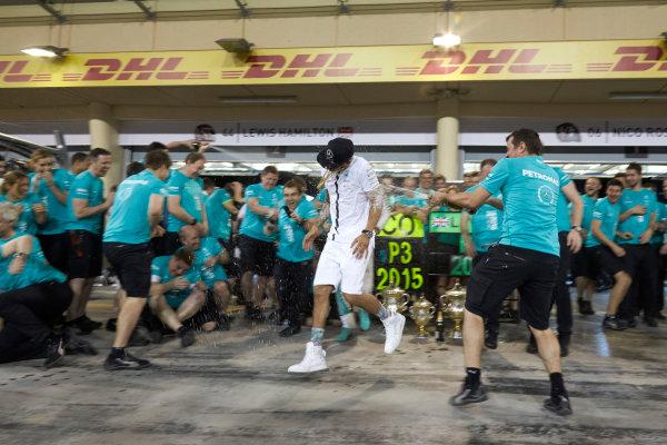 Bahrain International Circuit, Sakhir, Bahrain. Sunday 19 April 2015. Lewis Hamilton, Mercedes AMG, 1st Position, Nico Rosberg, Mercedes AMG, 3rd Position, and the Mercedes team celebrate victory. World Copyright: Steve Etherington/LAT Photographic. ref: Digital Image SNE15374