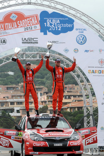 Nicolas Fuchs (PER) and Fernanado Mussano (ARG), Subaru Impreza WRX STi, win the production class on the podium. FIA World Rally Championship, Rd12, Rallye Italia Sardinia, Porto Cervo, Sardinia, Italy, Day Three, Sunday 21 October 2012.