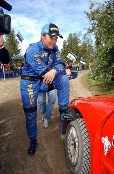 Petter Solberg (NOR), Subaru, waits nervously to hear if he has second place. He did!FIA World Rally Championship, Rd9, Neste Rally Finland, Jyvaskyla, Finland, Day 3, 10 August 2003.DIGITAL IMAGE