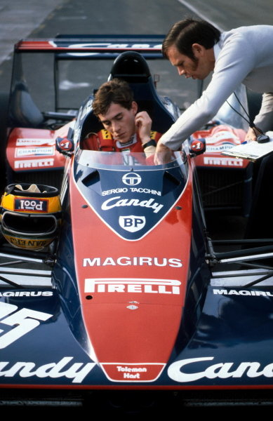 Ayrton Senna (BRA) talks with Rory Byrne (RSA) and prepares to test the Toleman TG183B for the first time. He would go on to make his Grand Prix debut with the team in the following season.  Formula One Testing, Silverstone, England, Autumn 1983.