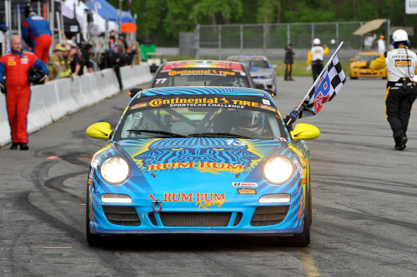 23-24 May, 2014, Lakeville, Connecticut USA 13, Porsche, 997, GS, Matt Plumb celebrates the win with checkered flag LAT Photo USA