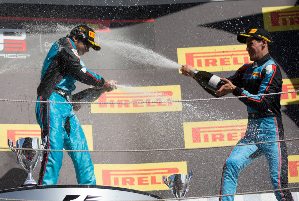 2017 GP3 Series Round 1.  Circuit de Catalunya, Barcelona, Spain. Sunday 14 May 2017. Winner of Race Two Arjun Maini (IND, Jenzer Motorsport) ,and third placed Alessio Lorandi (ITA, Jenzer Motorsport) on the podium with the champagne Photo: Jed Leicester/GP3 Series Media Service. ref: Digital Image JL1_0170