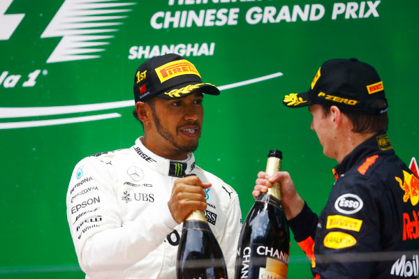 Shanghai International Circuit, Shanghai, China.  Sunday 09 April 2017.  Lewis Hamilton, Mercedes AMG, 1st Position, and Max Verstappen, Red Bull, 3rd Position, celebrate with Champagne on the podium. World Copyright: Steven Tee/LAT Images  ref: Digital Image _O3I5575
