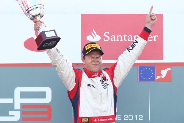 2012 GP3 Series, Round 3.Valencia, Spain. 24th June 2012. Sunday Race 2. Patric Niederhauser (SUI, Jenzer Motorsport) celebrates on the podium. Portrait. World Copyright:  Daniel Kalisz/LAT Photographic Ref: Digital Image IMG_2108