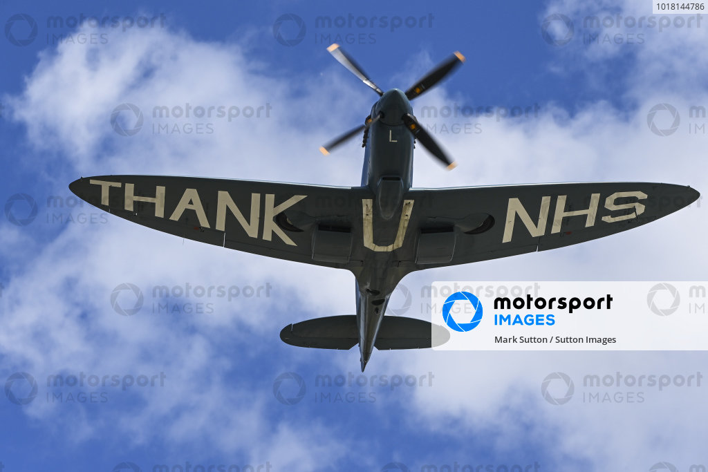 A Supermarine Spitfire PR.XI flies over the grid as a thank you to the NHS through the Covid 19 pandemic