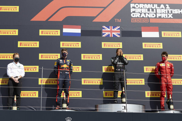Winner Lewis Hamilton, Mercedes-AMG Petronas F1, celebrates on the podium between Max Verstappen, Red Bull Racing and Charles Leclerc, Ferrari