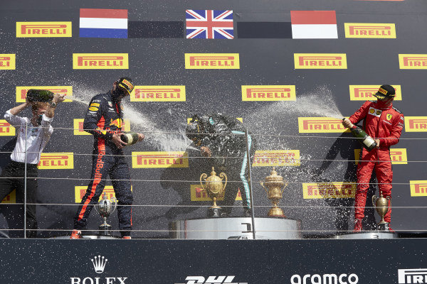 Winner Lewis Hamilton, Mercedes-AMG Petronas F1, celebrates on the podium with Max Verstappen, Red Bull Racing and Charles Leclerc, Ferrari