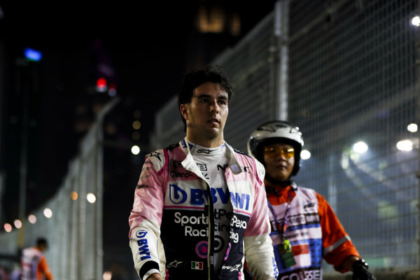Sergio Perez, Racing Point walks back to the garage after retiring from the race