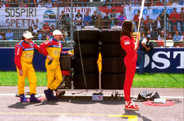Imola, Italy. 3-5 May 1996.  Jordan mechanics and grid girl wait for their car to arrive.  Ref-96 SM 16. World Copyright - LAT Photographic