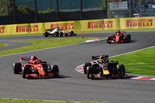 Kimi Raikkonen, Ferrari SF71H and Max Verstappen, Red Bull Racing RB14 battle