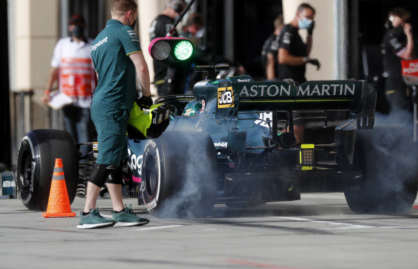 Lance Stroll, Aston Martin AMR21, lights up his rears in the pit lane