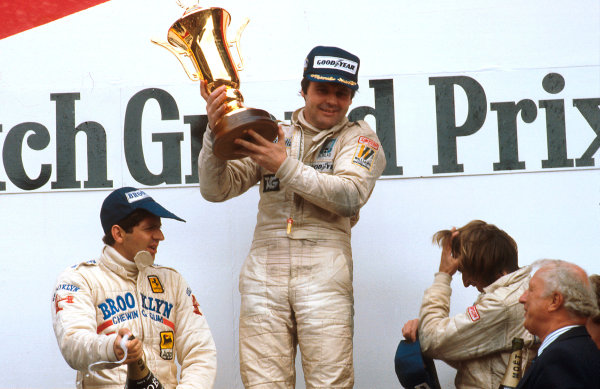 1979 Dutch Grand Prix.Zandvoort, Holland.24-26 August 1979.Alan Jones (Williams Ford) 1st position, Jody Scheckter (Ferrari) 2nd position and Jacques Laffite (Ligier Ford) 3rd position on the podium.Ref-79 HOL 05.World Copyright - LAT Photographic