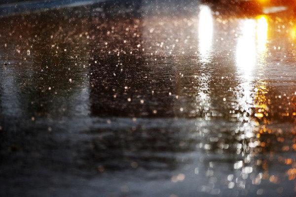 Rain falls in the pit lane