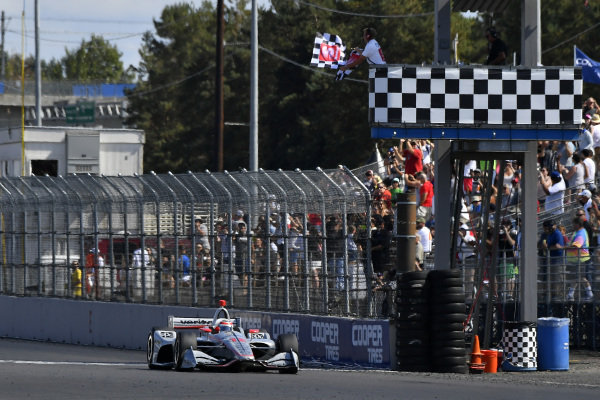 Will Power, Team Penske Chevrolet crosses the finish line under the checkered flag for the win