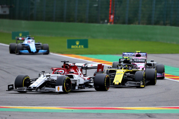 Kimi Raikkonen, Alfa Romeo Racing C38, leads Nico Hulkenberg, Renault R.S. 19, and Lance Stroll, Racing Point RP19