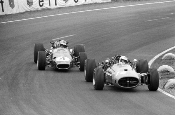 Guy Ligier, Cooper T81 Maserati leads Denny Hulme, Brabham BT24 Repco.