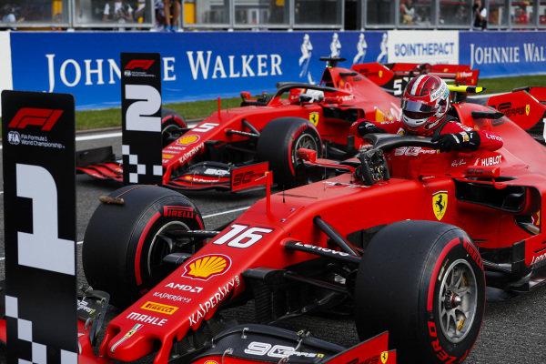 Charles Leclerc, Ferrari SF90, celebrates pole position, ahead of Sebastian Vettel, Ferrari SF90