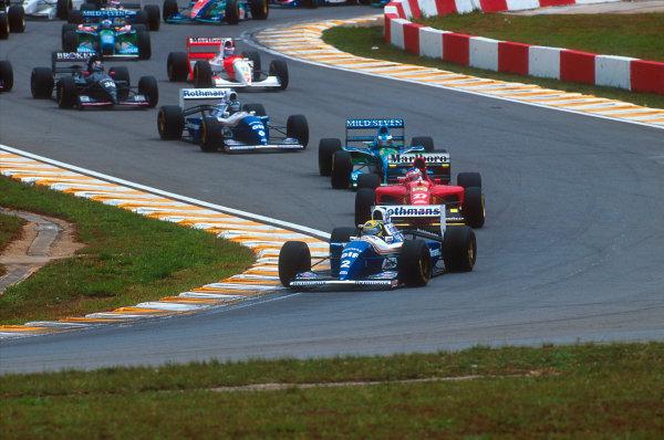 Interlagos, Sao Paulo, Brazil.25-27 March 1994.Ayrton Senna (Williams FW16 Renault) leads Jean Alesi (Ferrari 412T1), Michael Schumacher (Benetton B194 Ford), Damon Hill (Williams FW16 Renault), Heinz-Harald Frentzen (Sauber C13 Mercedes) and Mika Hakkinen (McLaren MP4/9 Peugeot) at the start.Ref-94 BRA 05.World Copyright - LAT Photographic