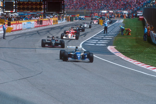 Imola, Italy.29/4-1/5 1994.Damon Hill (Williams FW16 Renault), Heinz-Harald Frentzen (Sauber C13 Ford) and others file around  behind the safety car, whilst marshalls clean up the track after the Lehto/Lamy startline shunt.Ref-94 SM 28.World Copyright - LAT Photographic