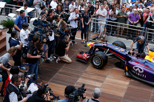 Monte Carlo, Monaco 22nd May 2013 Sebastian Vettel, Red Bull Racing meets Sebastian Ogier and shows him his car World Copyright: Charles Coates/LAT Photographic ref: Digital Image _N7T0546
